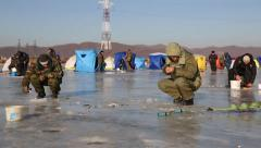 In winter, a lot of people catch fish from under the ice in the river. Russia Stock Footage