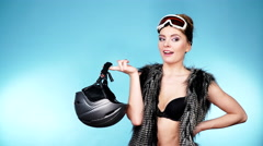Woman in ski googles holds helmet. Winter sport 4K - stock footage