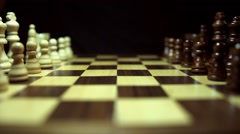 Side and wide angle shot of a chess board and the chess peaces lined up Stock Footage