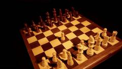 A chess board with a pawn in the middle of the board, the shot is moving Stock Footage