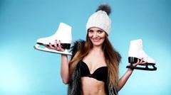 Woman wearing bikini fur vest with ice skates, winter sport 4K Stock Footage