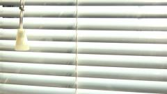 Window blind closeup dolly shot Stock Footage