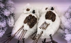 Couple of white owls made from natural materials. - stock photo