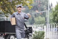 Stock Photo of Delivery person delivering package