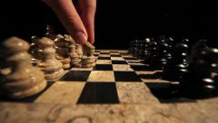 A person is starting a new chess game with his first move Stock Footage