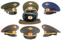 Different russian army officers caps over white background Stock Photos