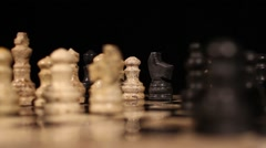 A chess game and a black bishop eats a white pawn - stock footage