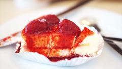 Eating and cutting white fluffy strawberry cheesecake - stock footage