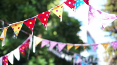 abstract colourful polka dots festival party flags in wind - stock footage