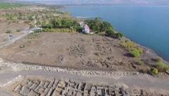 Aerial Israel. Capernaum ancient synagogue, Peter house excavations Galilee sea Stock Footage