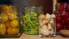 Salad ingredients in jars, crispy bread, tomatoes, green vegetable Stock Footage