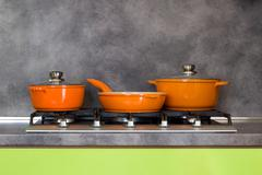 Pots and pan on the stove - modern kitchen Stock Photos