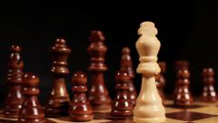 Footage of a white king being put in front of the white pieces on a chess board Stock Footage