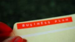 Document written business plan on it Stock Footage