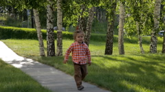 Boys running along the path one after another. Stock Footage
