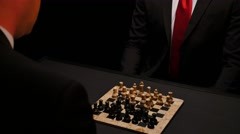 Two adults playing chess in a dark room - stock footage