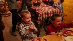 Children eating dinner at a family christmas party - stock footage