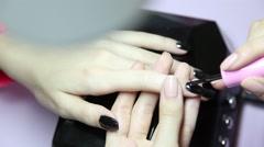 Manicure. Beauty saloon. Close-up. Apply black nail polish - stock footage