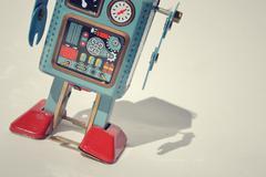 Vintage tin toy robot isolated on white background, filtered retro photo - stock photo