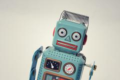 Vintage tin toy robot isolated on white background, filtered retro photo Stock Photos