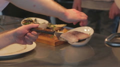 Fish being prepared by chef in kitchen Stock Footage