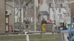 Fishermen in harbour in Pitenweem, Scotland Stock Footage