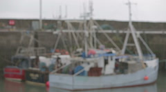 Small fishing vessel in Scottish harbour Stock Footage