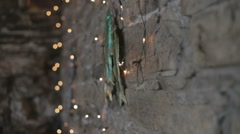 Fairy lights against brick rustic wall - stock footage