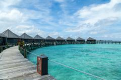 a water bungalow on an island - stock photo
