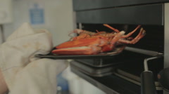 Chef removing lobster from grill Stock Footage