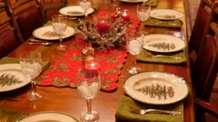 Table set for a fun christmas dinner Stock Footage