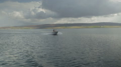 Small moving boat on Scottish sea loch Stock Footage