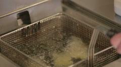 Chef deepfrying sea food in restaurant kitchen - stock footage