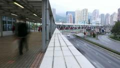 People walk at pedway above city traffic on road, time lapse, twilight time Stock Footage