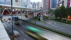 Evening city junction traffic, pedestrian pedway above, time lapse shot Stock Footage