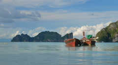 Pair small fisher boats near Phi Phi island Stock Footage