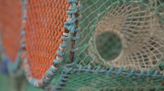 Lobster creels sitting at a harbour in Scotland Stock Footage