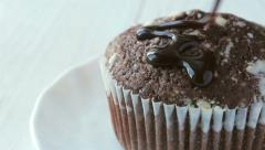 Cupcake sprinkled with chocolate - stock footage