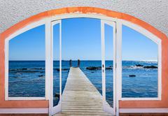 open window to the sea - stock photo