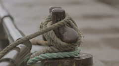 A fisherboats lines attached to a harbours bollard - stock footage