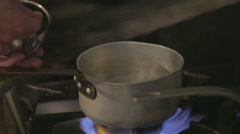Chef in restaurant kitchen cooking with pans Stock Footage