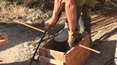 Blacksmith is Using Metal Cutting Saw During Historical Reenactment Stock Footage