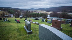 A graveyard on a cloudy, rainy day - stock footage