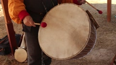 Tourist is Playing on Old Ancient Drum During Historical Reenactment Stock Footage