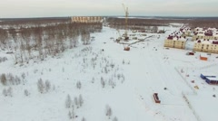 Construction of high-rise buildings in the winter. Aerial view Stock Footage