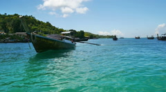 Longtail boat sails to berth near the Phi Phi island Stock Footage