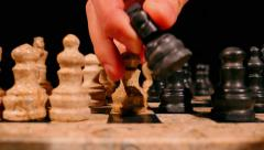 Low angle footage of a chess game and a black knight takes a white pawn Stock Footage