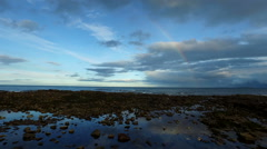 Aerial shot into sea off the coast of Fife, Scotland Stock Footage