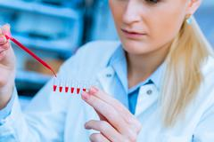 Scientist woman in genetic laboratory Stock Photos