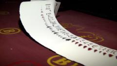 Casino, poker. The dealer lays the cards out on the red velvet table . - stock footage